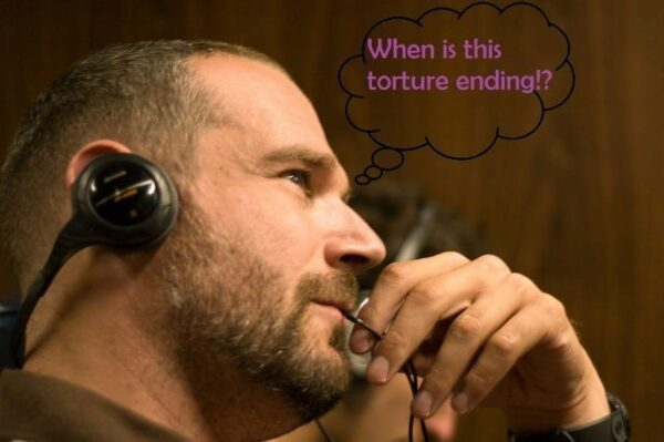 Man on headset thinking when is this torture ending