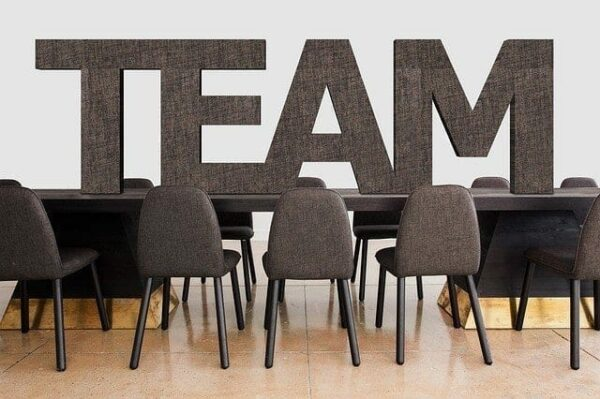 table with the words 'team' on it - company culture