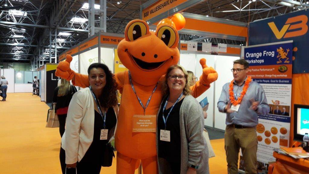 Mascot with presenters at the World of Learning Expo
