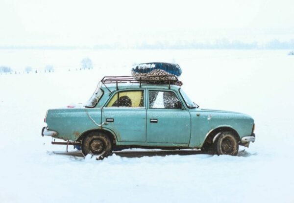 Old car stuck in snow.