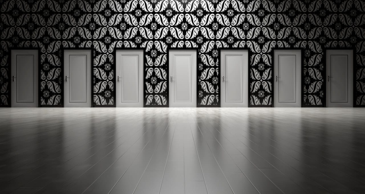 Series of doors on a patterned wall
