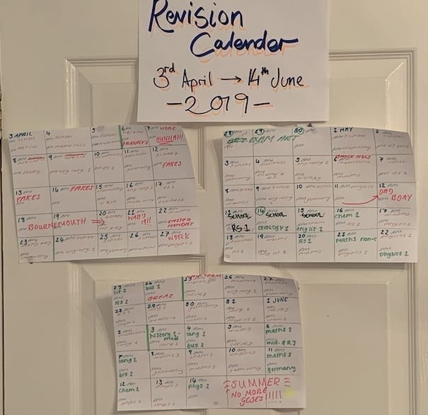 Revision calendars taped to a door