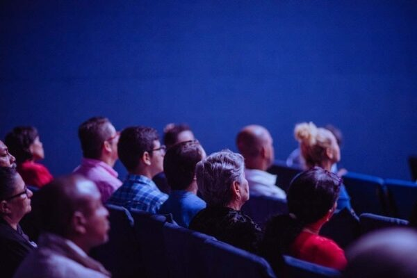 An audience listening to a presentation.