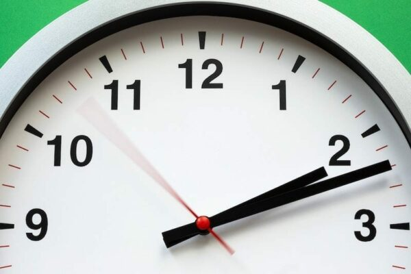 Close up shot of a clock pointing 2:12