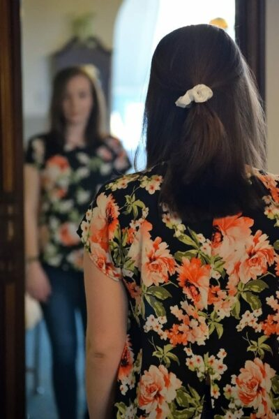 Woman practising in the mirror