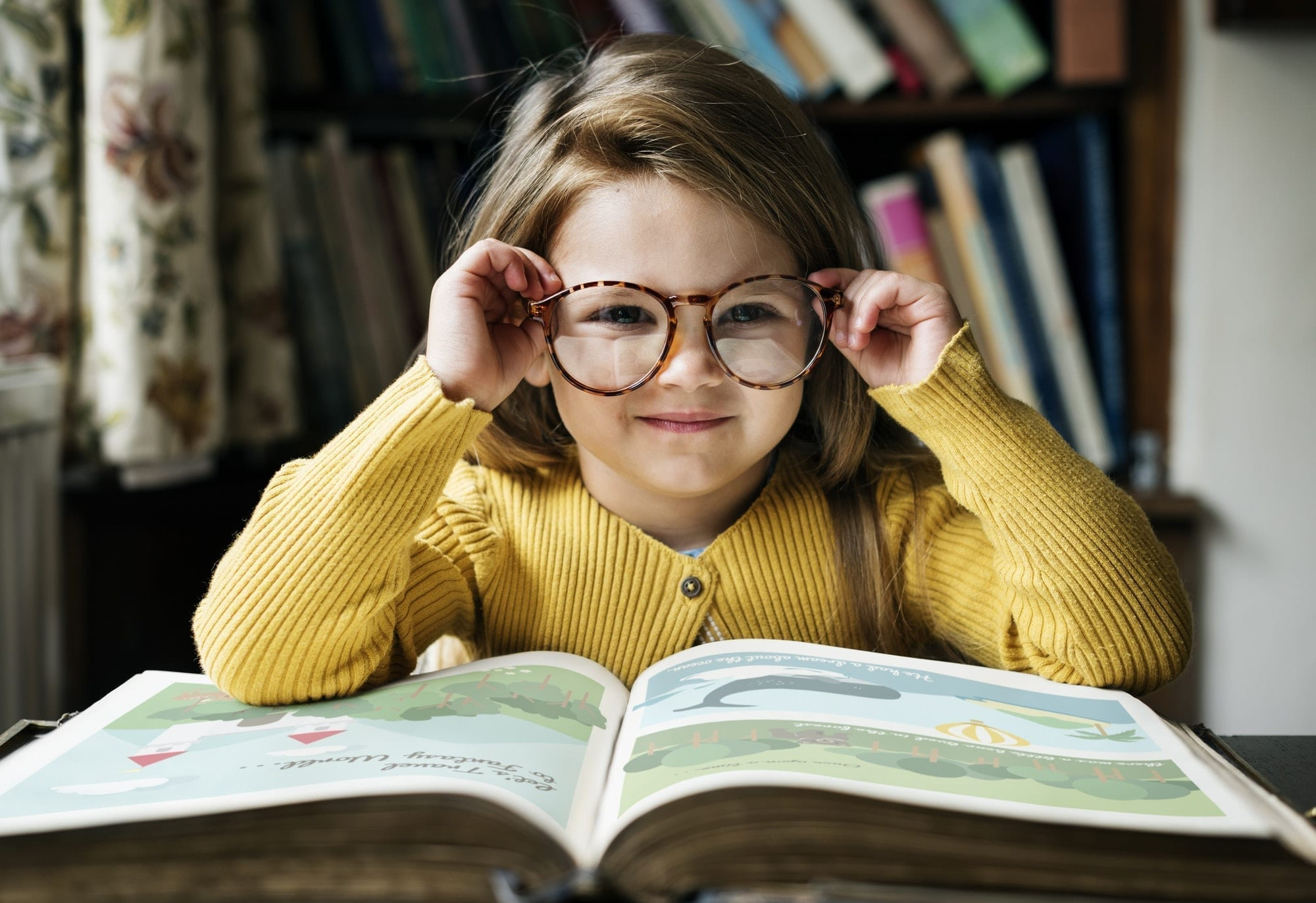 A girl is shown with an open book in front of her, thus satisfying the first tip of presentations... to tell a story!